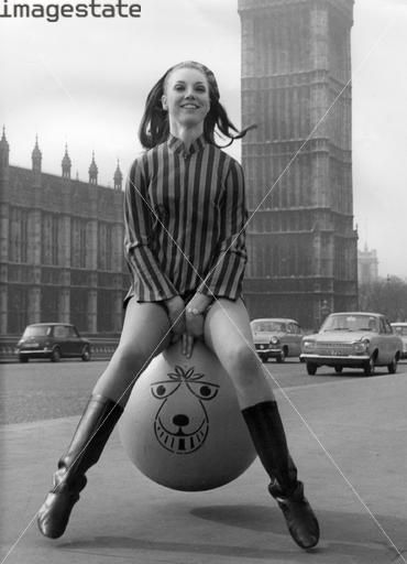 Girl on a space hopper, London, c1971.Had one of these as a kid,orange with that same strange face,used to hop all over the place on it!