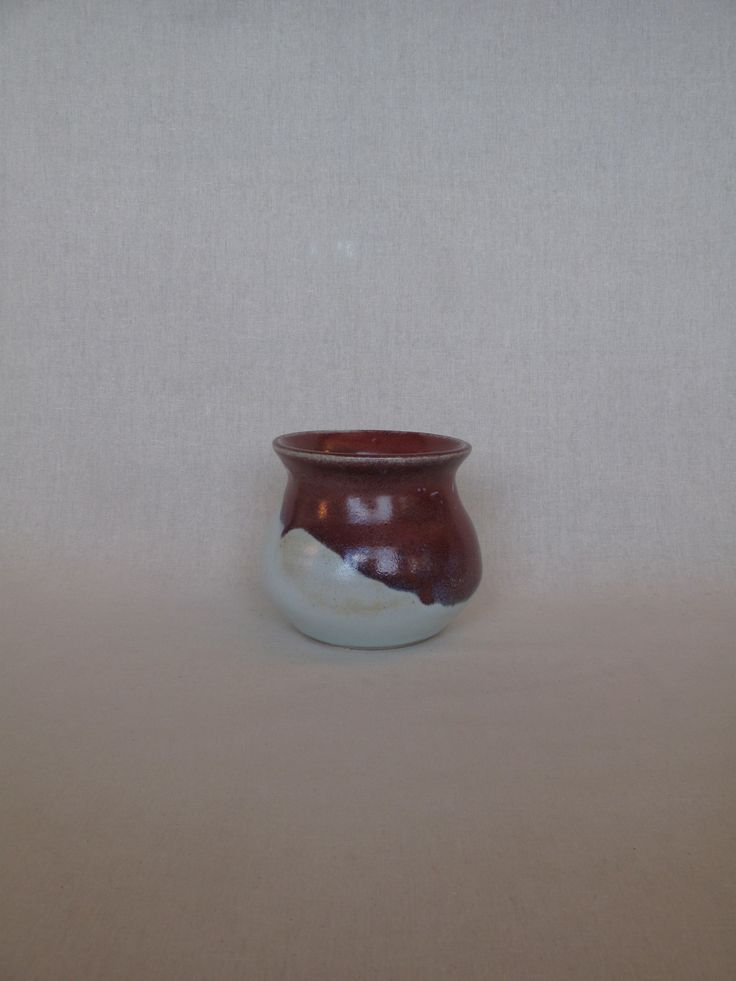 Squat pot by Janine Flew, glazed in chun and strawberry red