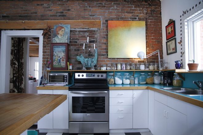 Wooden counters and place for toaster oven and storage jars - eclectic kitchen by Esther Hershcovich