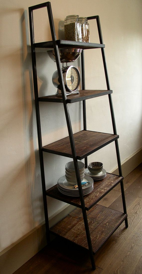 Beautiful industrial style free standing ladder shelf, ideal for display and storage at home or retail setting.  Dark steel box section frame with dark distressed wood shelves set within a steel frame give the shelving a lovely heavy duty uncomplicated feel, typical of the industrial look.  The shelves are strong enough for heavy items, such as pans, jars, tins or books, and high enough to take 12 inch vinyl records. The stepped shelving provides a lovely setting for displaying/storing…