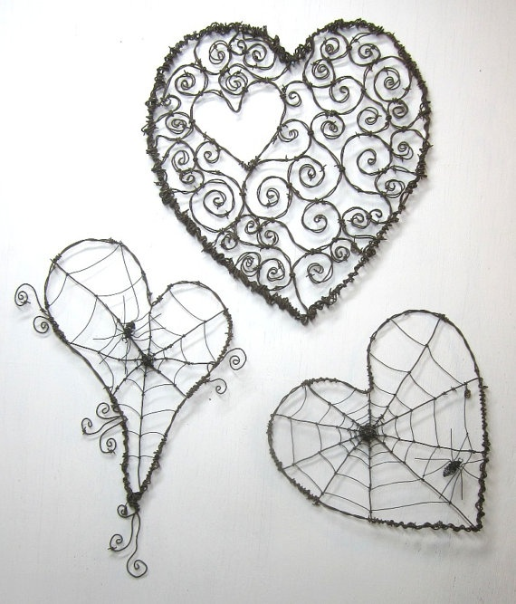 Barbed Wire art~ Spider web hearts.  These are amazing!