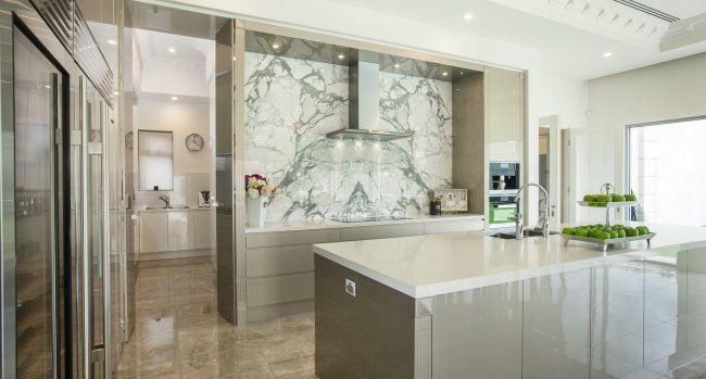 The butler's pantry to the side allows you to keep the main kitchen clear and uncluttered...