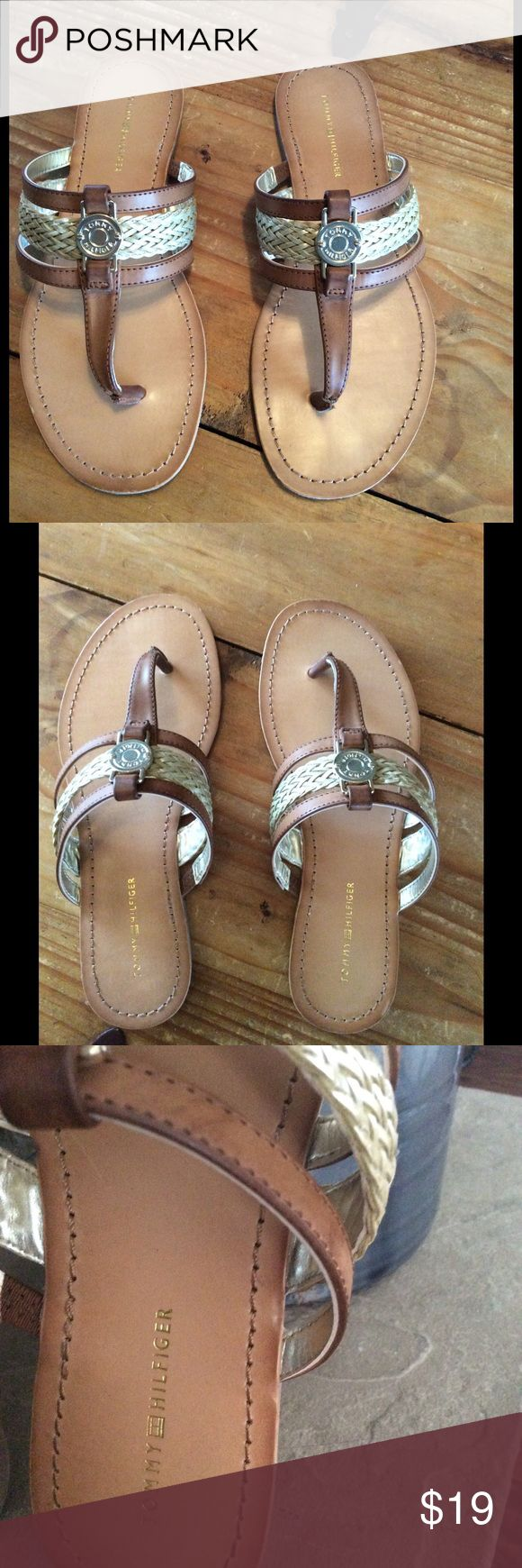 Tommy Hilfiger brown leather sandal. NEVER WORN. Brown leather sandal with 2 leather straps and decorative gold braiding in the middle. To finish the look a Tommy Hilfiger buckle on top. Tommy Hilfiger Shoes Sandals