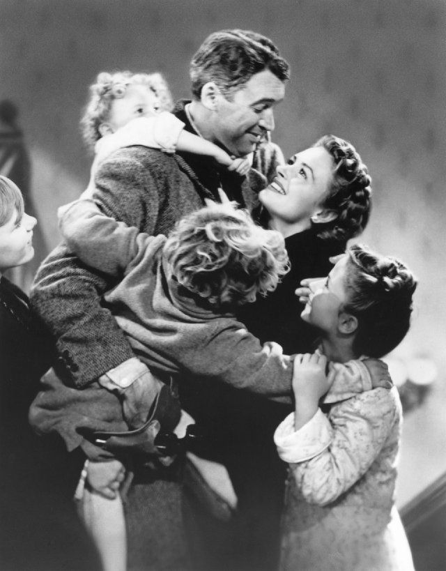 James Stewart, Donna Reed, Carol Coombs, Karolyn Grimes and Jimmy Hawkins in It's a Wonderful Life