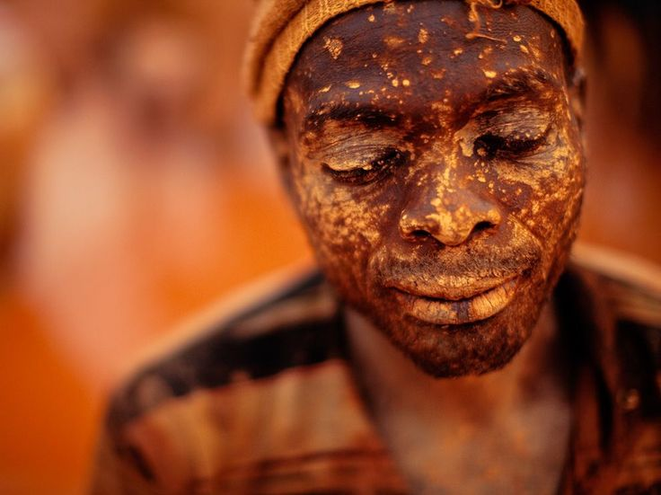 Gold Miner, Mozambique. The glowing hues of dusk bathe a mud-splattered gold miner in the border province of Manica. Incredible picture.