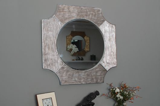 The Lucas silver wall mirror. Traditional and formal by design, these wall mirrors are influenced by Greek and Coptic crosses. Our Lucas silver mirror is hand carved and cast in silver metal leaf with antique finish. Very elegant this mirror accentuates any room with style, grace and beautiful design, it works particularly well above a console table or mantelpiece. We love it with both contemporary and more traditional home décor.