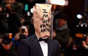 Raising the bar for the most OMG fashion moment indeed you'd be inclined to think that the crown of title in question would go to her rival or something – WRONG. Step forward Jared Letho who bizarrely took to the red carpet of the premiere of Nymphomaniac Volume 1 at the Berlin International Film Festival  with a paper bag over his head emblazoned with 'I'M NOT FAMOUS ANYMORE' – Well we did say that fashion was all about making a statement and he certainly made his – although bizarre it may…