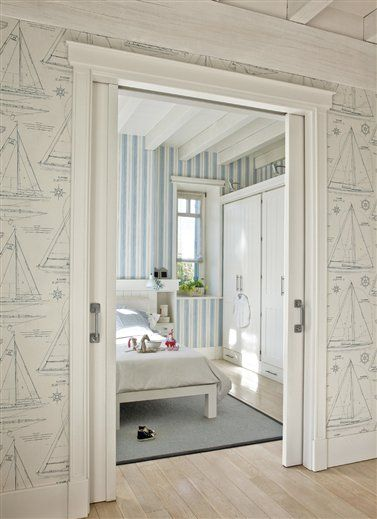 New England classic.  Nautical wallpaper, pocket doors, and bleached wood....