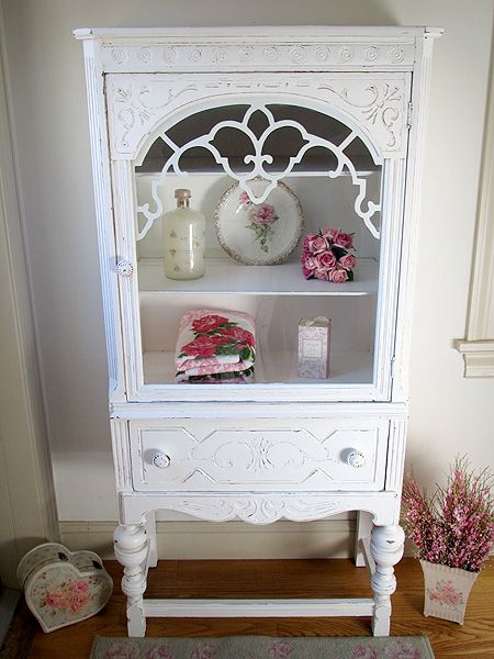 hang antique china cabinet on bathroom wall, open shelving on either side