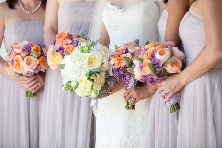 Peach and Lavender Wedding Bouquets | Peach-purple-bridesmaids-bouquets-with-bride-in-ivory.full