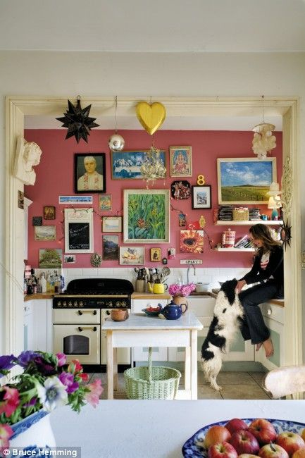 Former stylist Anna Richardson's Hastings home is the perfect canvas for her magpie eye. In the kitchen, the vibrant pink walls - painted in Rhubarb from Paint & Paper Library (tel: 020 7823 7755, paintlibrary.co.uk) - add warmth, as does the display of pictures bought on holiday and in galleries and second-hand shops in Hastings old town.