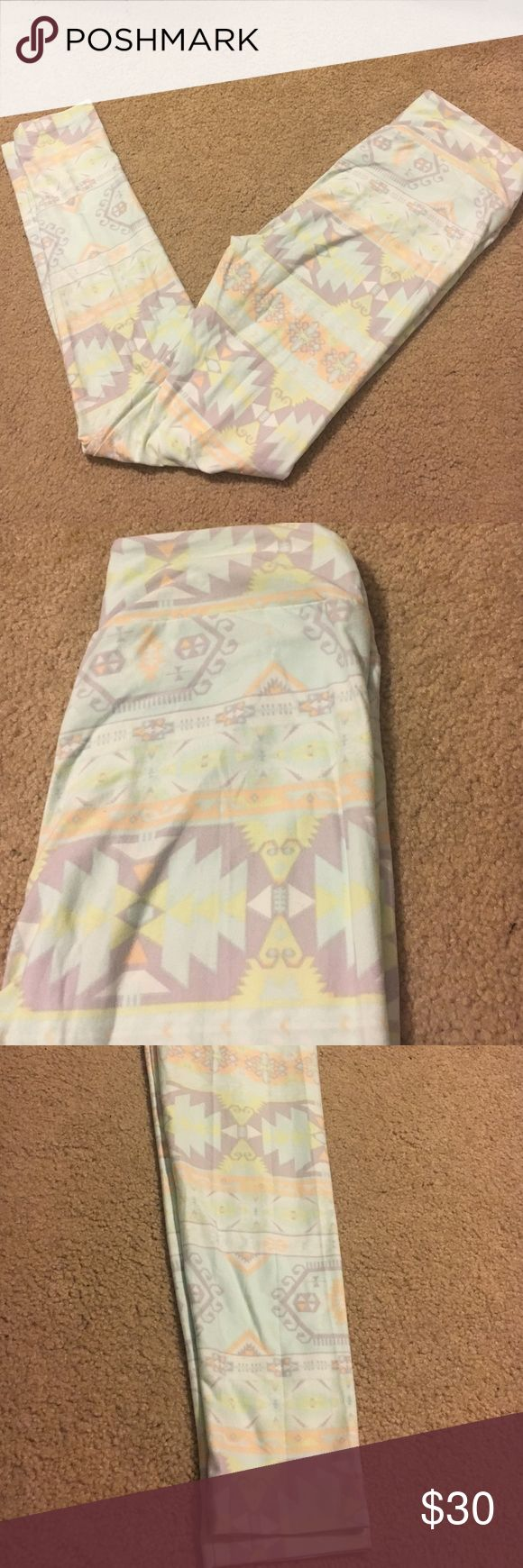 LulaRoe OS Pastel Aztec Print Leggings LulaRoe pastel blue, green, purple and orange Aztec print leggings. OS - one size - fits most 0-12 LuLaRoe Pants Leggings