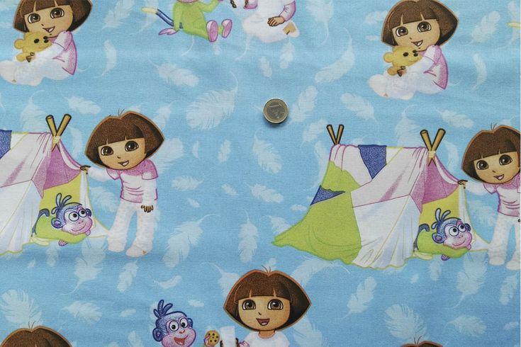 Algodón de dora la exploradora con fondo celeste, conviene lavarlo previamente a la confección en agua tibia para que el tejido mengüe. Tejido ideal  para la confección de niños tales como vestidos, mantas, mandilones...#algodón #dora la exploradora #niños #bebés #fresco #fresca #camisas #vestidos #confección #azulón #blanco #telas #tela #textil #tejidos #tejido #prenda #ropa #telasseñora #telasniños #comprar #online