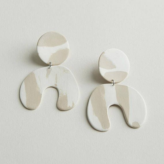 Colored porcelain earrings •thin and lightweight •sterling silver post •unglazed •each piece is hand cut and may vary a bit •3 3/8 L x 2 1/4 W Care Porcelain jewelry is actually pretty durable, and if cared for, can have a nice long life. Store them separately from other jewelry
