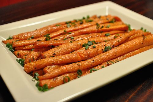 Pioneer Woman's recipe for baked carrots.   Coat carrots with olive oil and sprinkle with thyme.400* for 35-40 minutes..that's it!