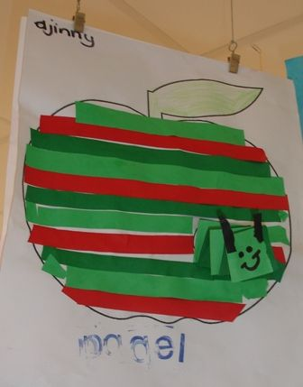 Stripe apple craft with paper folded worm. I could use it to teach AB patterns…