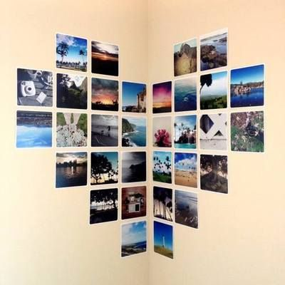 Photo wall corner. Good for Travel themed room. Use different sized photographs from places travelled.