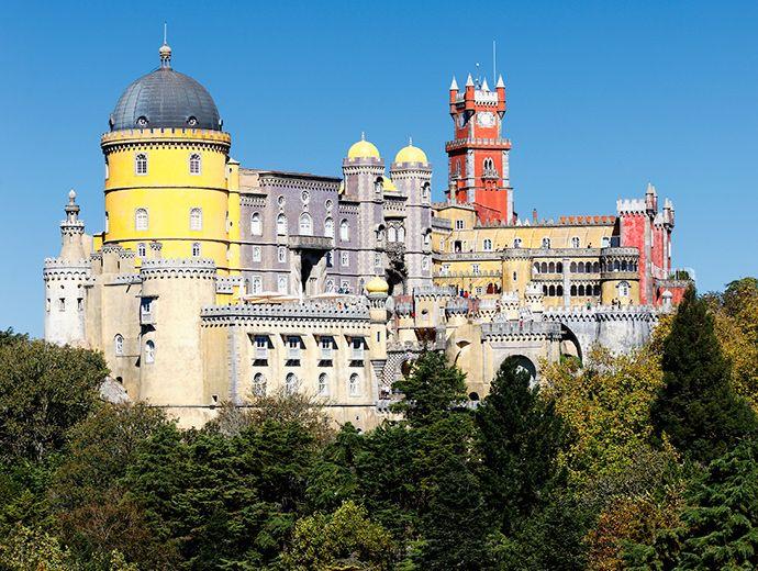 The Palace of Pena near #Lisbon, #Portugal is a fairy tale-like 19th-century construction of King Ferdinand II: http://enroute.aircanada.com/en/articles/romantic-lisbon // Le palais de Pena près de #Lisbonne au #Portugal est une fantastique construction du roi Ferdinand II, datant du 19e siècle: http://enroute.aircanada.com/fr/articles/lisbonne-en-amoureux-5-experiences-romantiques