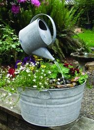 Wash tub water feature, watering can appears to be hanging in air
