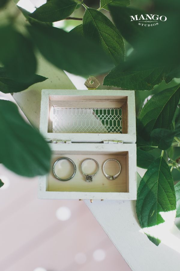 #weddings #rings #band #diamonds #silver #outdoors #green #leaves #white #box #bride #groom #jewelry #photography #mangostudios Photography by Mango Studios