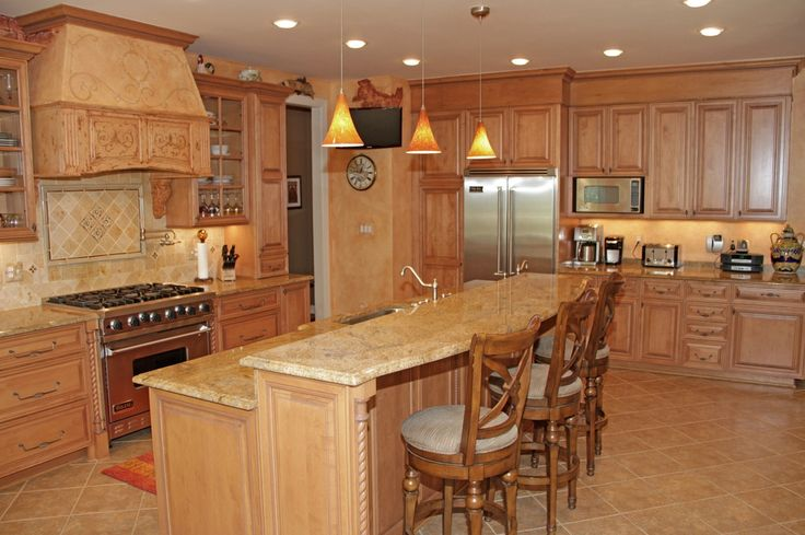 French or Scandinavian country kitchen with light-wood cabinets (Complex granite counters, limestone tile floors)