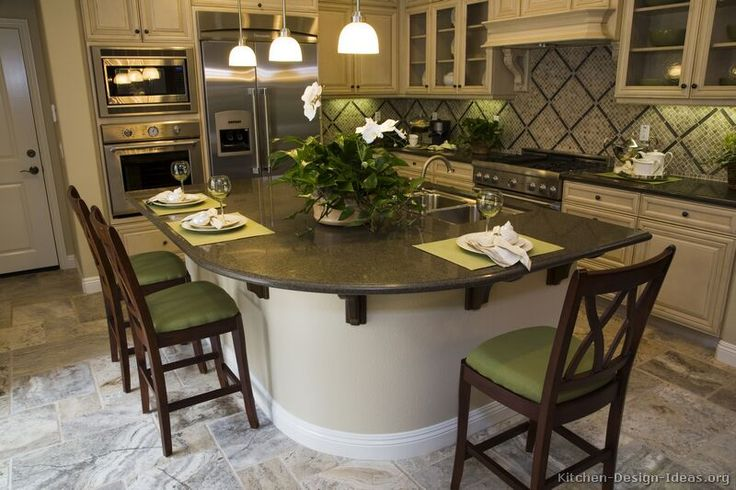 Traditional Antique White kitchen - with a curved breakfast bar