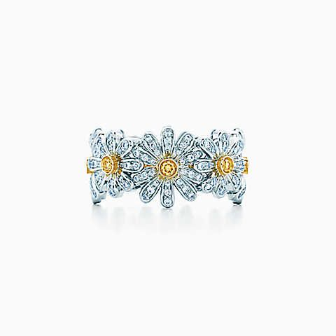 Tiffany & Co. Schlumberger® Daisy ring in gold with yellow and white diamonds.
