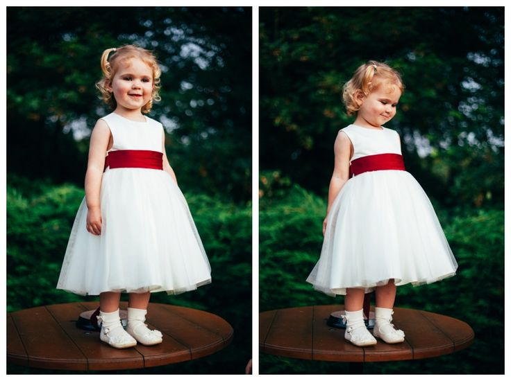 Cute adorable flower girl in gorgeous white dress