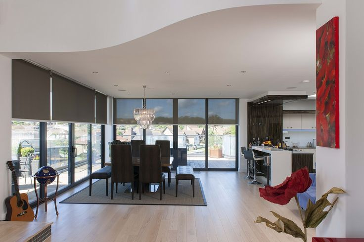 Winning Project - Private Residence in Kent. This room uses Silent Gliss electric roller blinds with a screen fabric to balance between light and privacy.