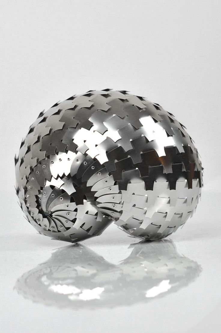 Stainless steel sculpture with rivets