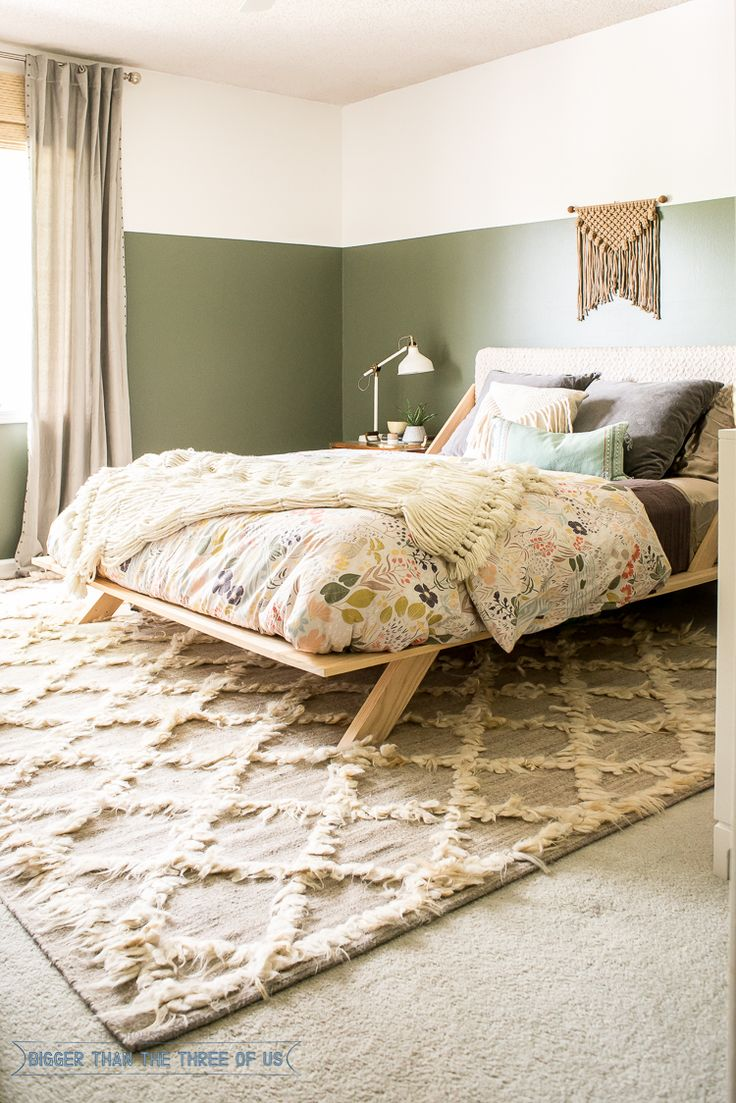 Boho Modern Eclectic Bedroom featuring a bohemian rug, schoolhouse electric duvet, target decor, DIY bed, and a wall hanging.