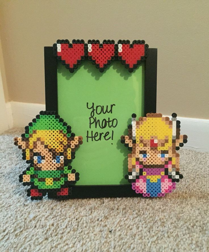 A personal favorite from my Etsy shop https://www.etsy.com/listing/268156459/link-and-zelda-picture-frame