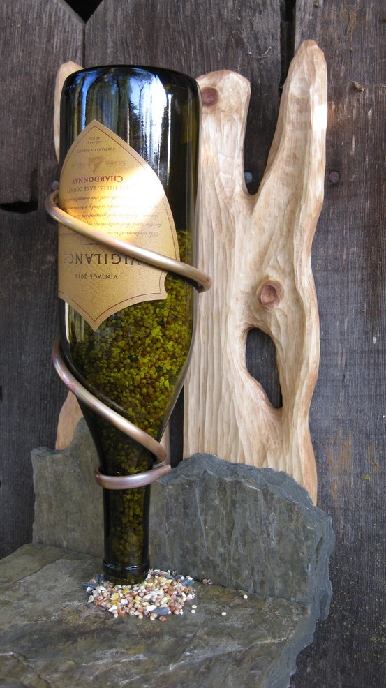 This is a beautiful, unique, and rustic one of a kind, hand-crafted bird feeder. It is sculpted pine with a rustic and durable slate base.