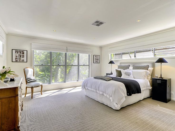 Master bedroom with classic white interior design.
