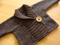Ribbed Baby Jacket pattern by Debbie Bliss