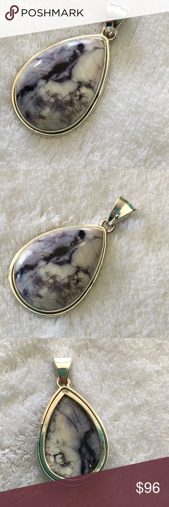 Tiffany Stone Pendant (B) in .925 silver Rare stone  - opalized bertrandite fluorite - also known as Tiffany Stone.  A variety of Fluorite specially from Utah. Large tear drop shaped  Pendant - exhibits many of the minerals associated typically with Tiffany Stone- white to pale to dark purple - set in .925 silver.  Stone description- A fine-grained purple to pale violet fluorite, usually with swirl patterns sometimes with small impurities of intergrown bertrandite, chalcedony, opal, and/or…