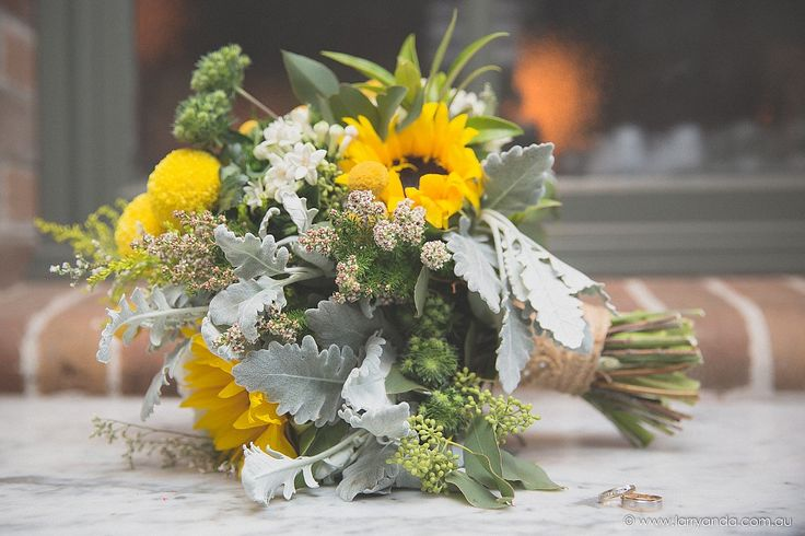 A very unique garden bouquet. It added up to that Rustic vintage appeal that i wanted, with sunflowers, billy buttons and hydrangeas. #thegroundsfloralsbysilva #floralsbysilva