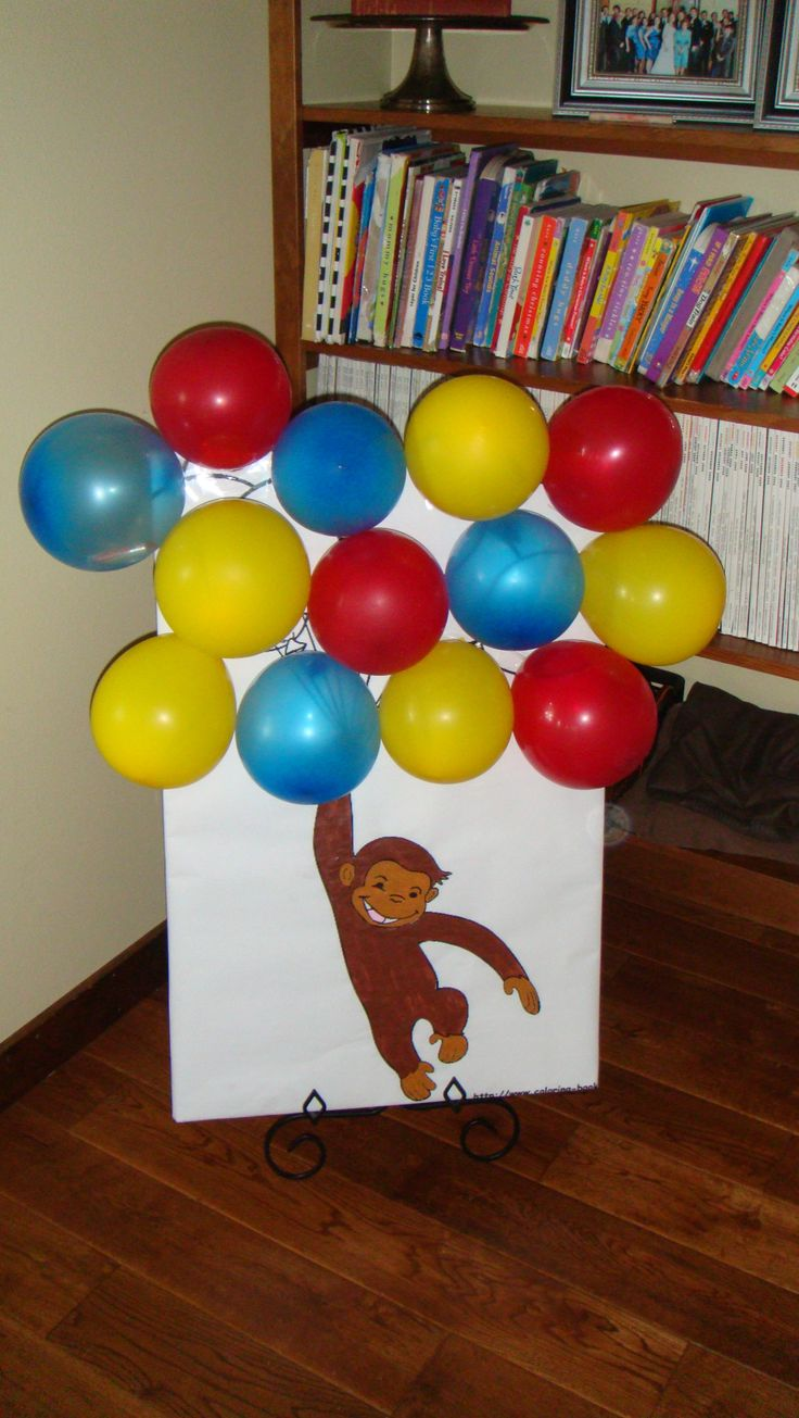 Curious George games_ pinata alternative: pop the balloon to claim your candy                                                                                                                                                                                 More