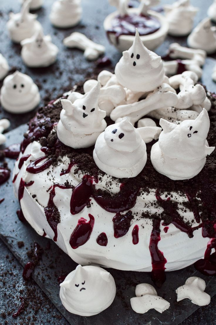 Halloween haunted pavlova - a spooky, impressive centerpiece with meringue ghosts and bones, Oreo soil and berry coulis blood; it is easier to make than you might think!