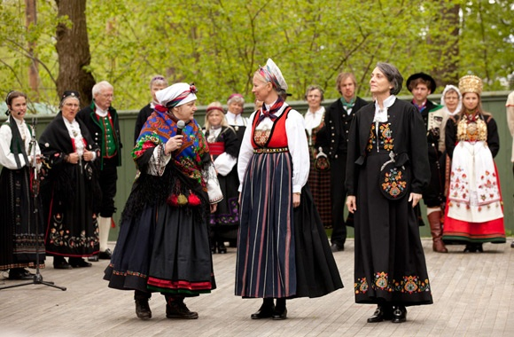 Book-release-Scandinavian-Folklore.15 Curator Pedersen,in a Telemark Beltestakk is presenting the reconstructed Embroidered bunads from Valdres