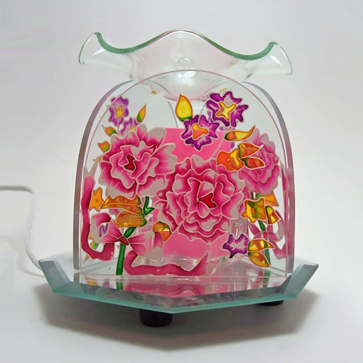 Burst of Flowers Glass Electric Scented Oil Fragrance Warmer - OWEF201 - Glass electric scented oil fragrance warmer. Colorful flower design etched into three clear glass sides with round tops. Octagon mirror base. Scalloped glass bowl for your fragrance choice. Dimmer dial, with on / off switch, lets you control the light, heat and aroma intensity. FOR SALE