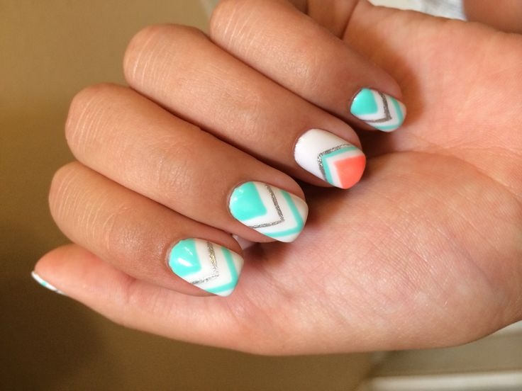 Bright turquoise and coral chevron nails