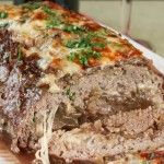 French Onion Soup au Gratin Stuffed Meatloaf, with its caramelized onions and ooey, gooey cheese and soup-y gravy, is the ultimate comfort food mash-up.