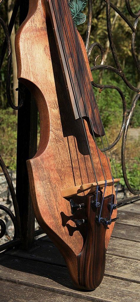 "Sergey Poedinko of Dahrendorf Guitars sent us the details for this gorgeous electric upright bass, and I knew we had to share it. Dubbed the Darwin EUB34, the bass mixes elements of both electric and upright basses into a minimalist design. ""It has [an] absolutely 'upright' sound in its compact body that fits regular bass..."