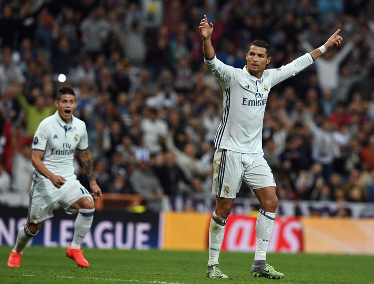 Real Madrid's Portuguese forward Cristiano Ronaldo celebrates after scoring during the UEFA Champions League football match Real Madrid CF vs Sporting CP at the Santiago Bernabeu stadium in Madrid on September 14, 2016.