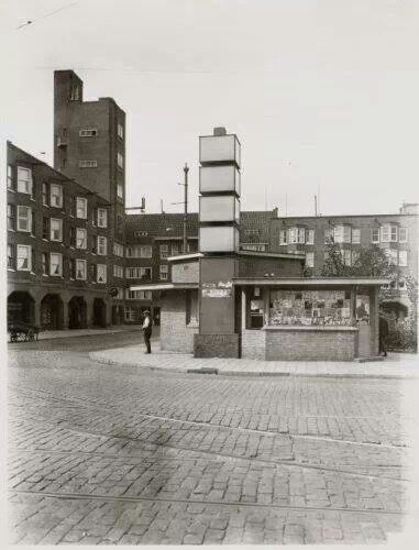 1935 - 1940. A view of the Mercatorplein in Amsterdam. The Mercatorplein borders the Hoofdweg at the junction with the Jan Evertsenstraat. The square was designed by H. P. Berlage in 1925 and built in the late 1920's. Remarkable were the two gate buildings with towers on the north and south-side of the square. In 1998 and later in 2008 the square was extensively renovated. #amsterdam #1940 #Mercatorplein