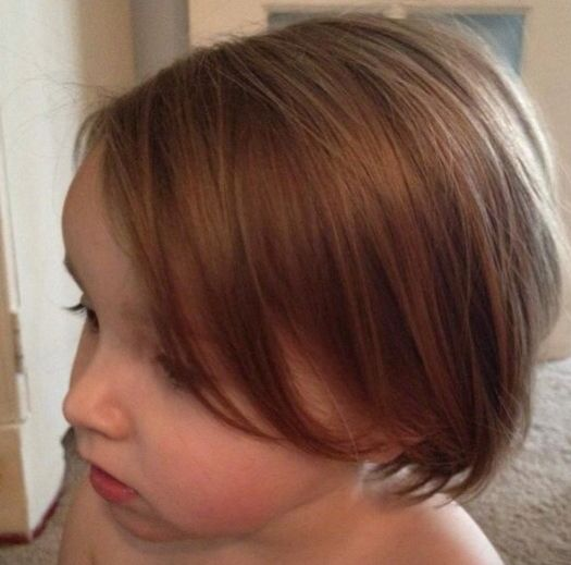 Front view of wispy hair cut for toddler girl/child