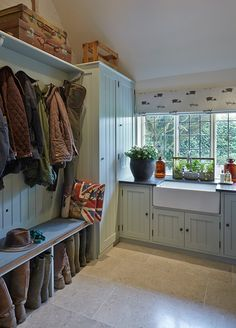 Love this look for our utility room - panelling and butler sink with built in washer and dryer and coat rack