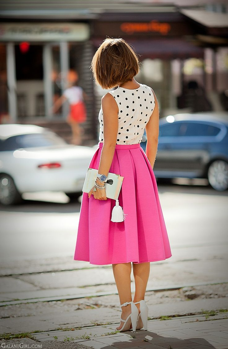 Black and white polka dot shirt + bright pink midi skirt