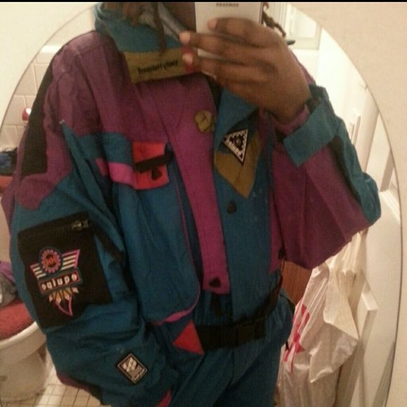 Helly Hansen full body one peice ski suit Normal signs of where. Barely worn. Small rip on the back by the arm as shown Helly Hansen Jackets & Coats
